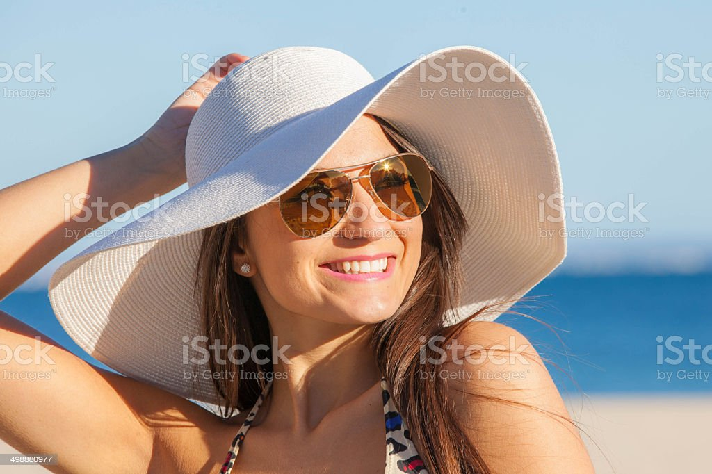 woman on vacation with  sun hat and glasses. stock photo
