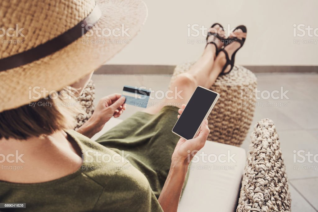Woman on vacations is shopping online stock photo