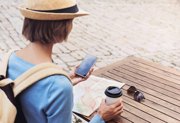 Woman on vacations using phone stock photo