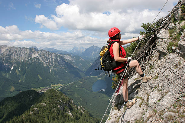 woman on via ferrata in styria, austria - clambering stock photos and pictures