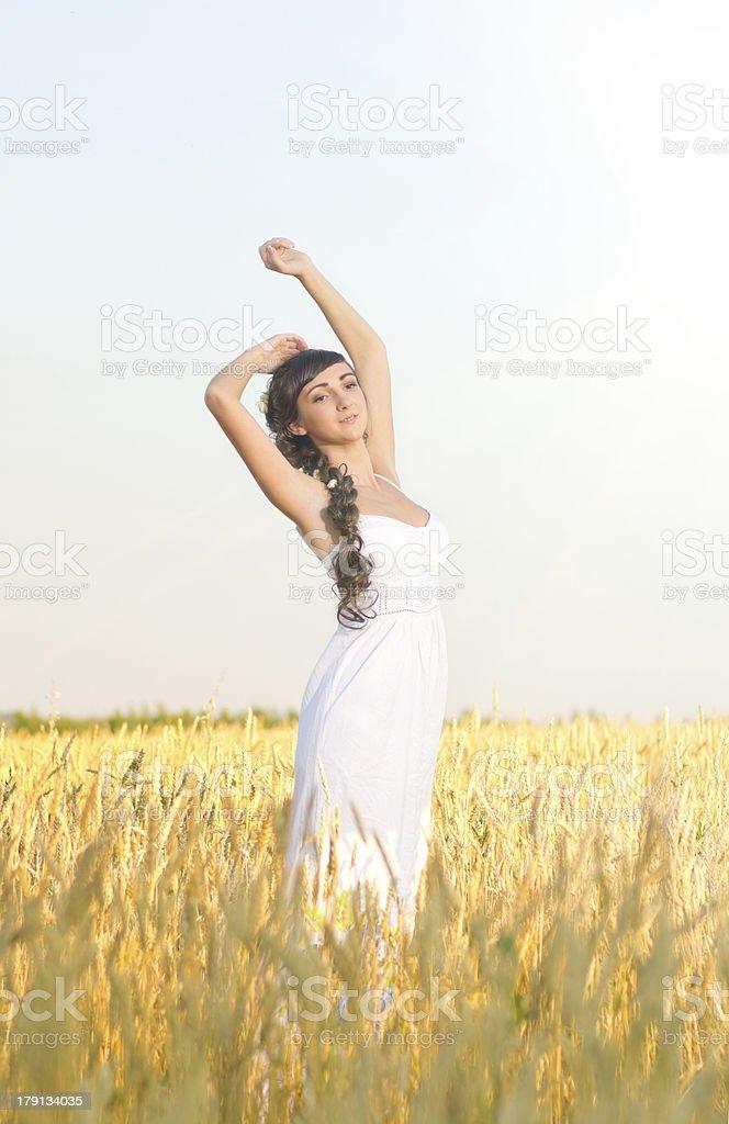 Woman on wheat field royalty-free stock photo