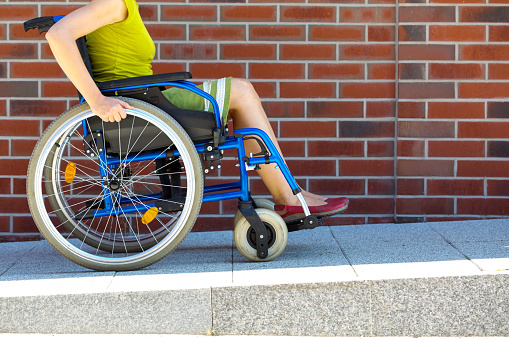 Woman On Wheelchair Entering The Platform Stock Photo - Download Image Now