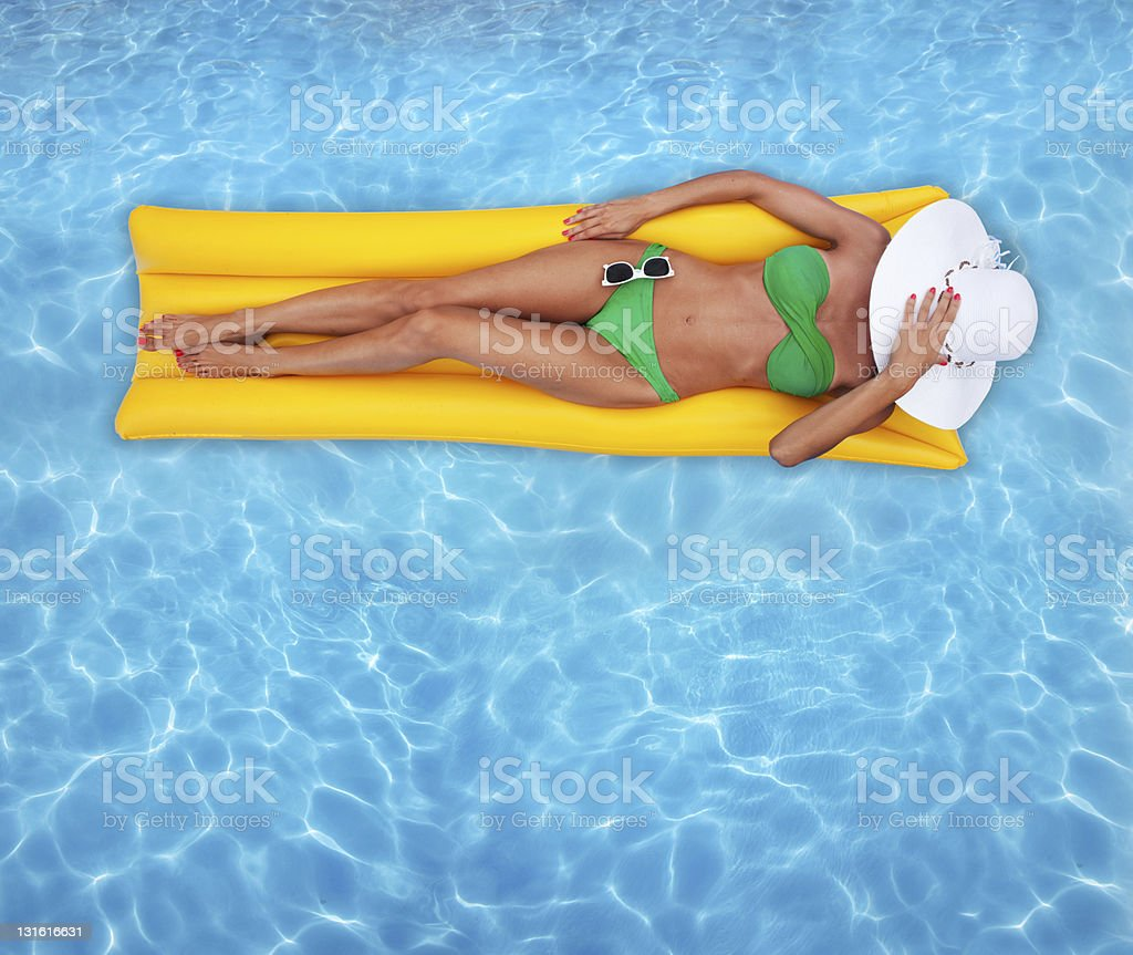 Woman on yellow raft in a swimming pool royalty-free stock photo