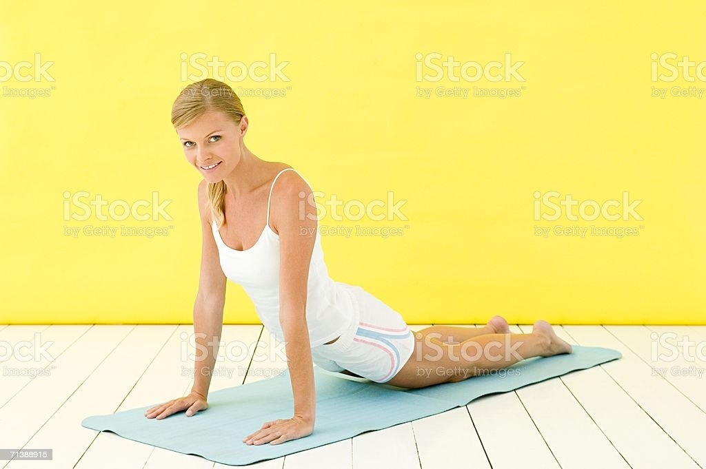 Woman on yoga mat royalty-free stock photo