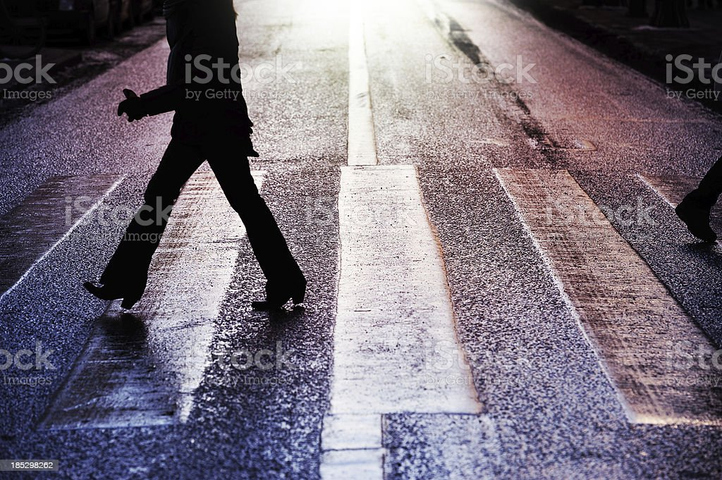 Woman on zebra crossing royalty-free stock photo