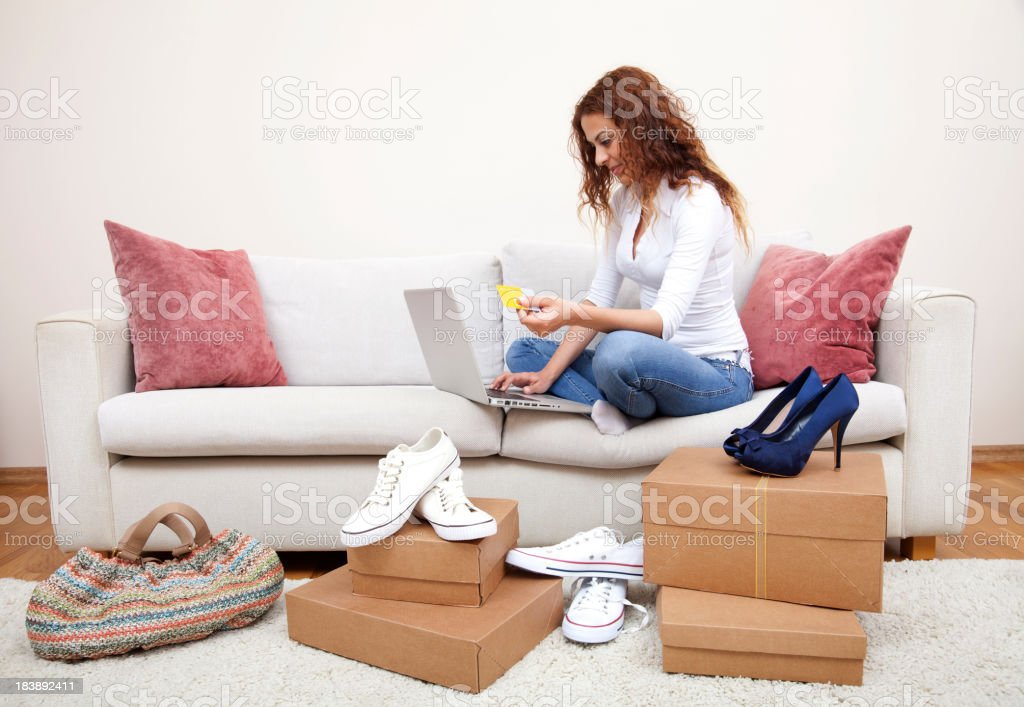 Woman online shopping for shoes royalty-free stock photo