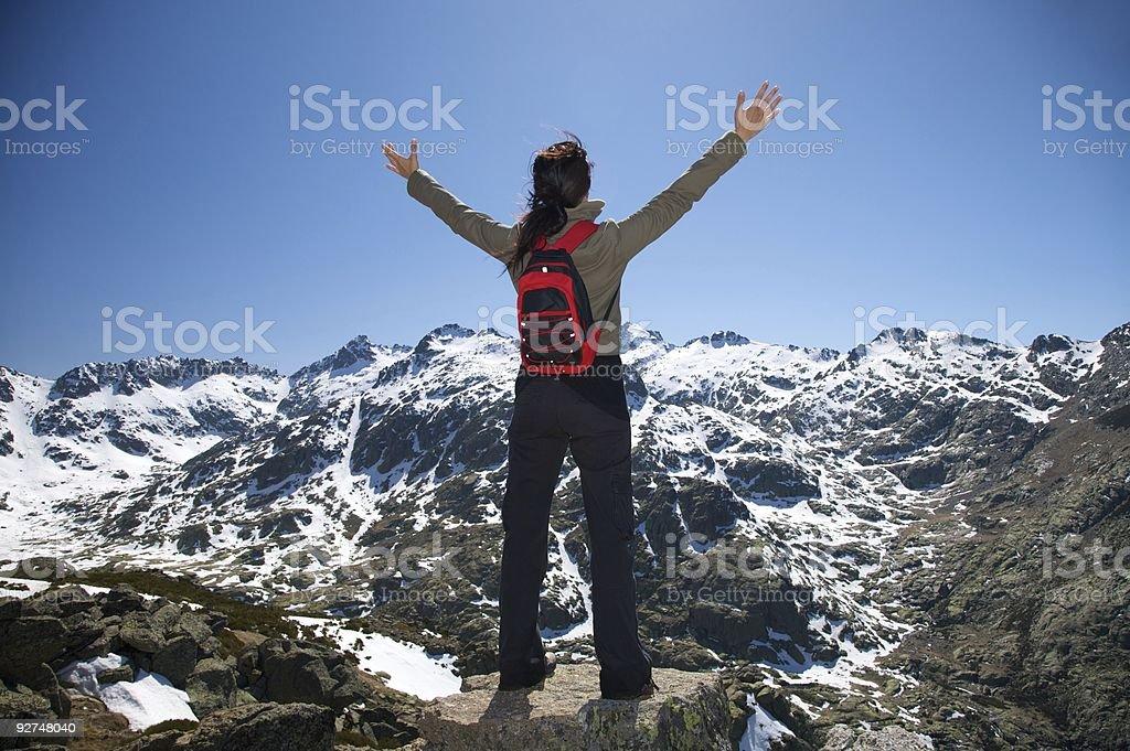 woman open arms cross hello top snow mountain nature royalty-free stock photo