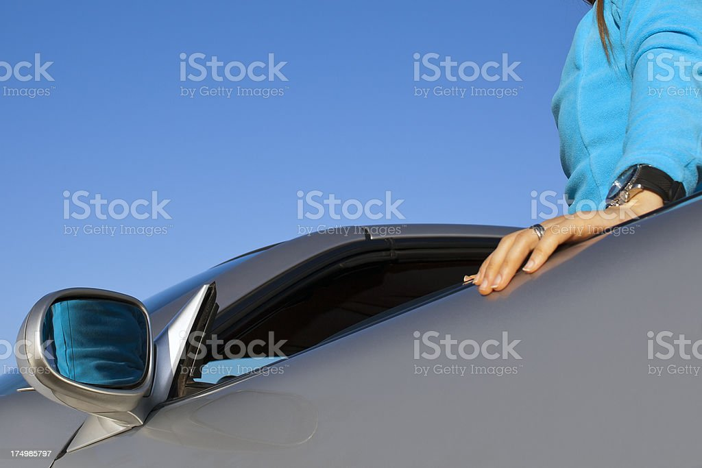 Woman open the coupe door. royalty-free stock photo