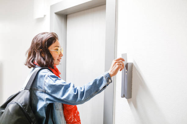 Woman open the Hotel door with electronic key card, access control system Woman open the Hotel door with electronic key card, access control system cardkey stock pictures, royalty-free photos & images