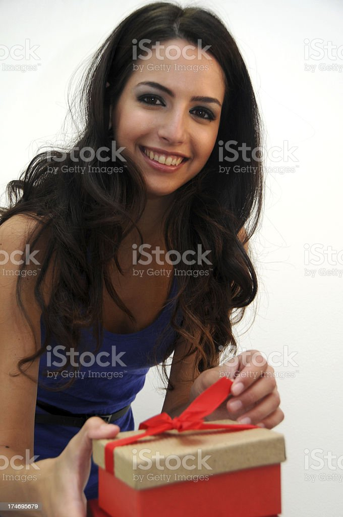 Woman opening a  present royalty-free stock photo