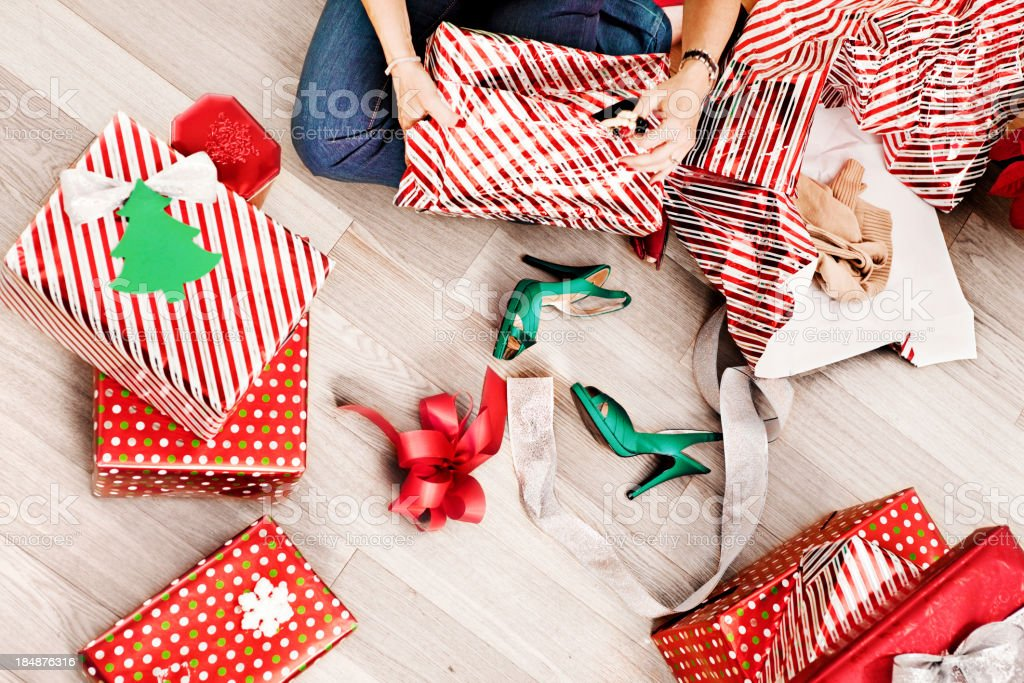 Woman opening christmas presents stock photo