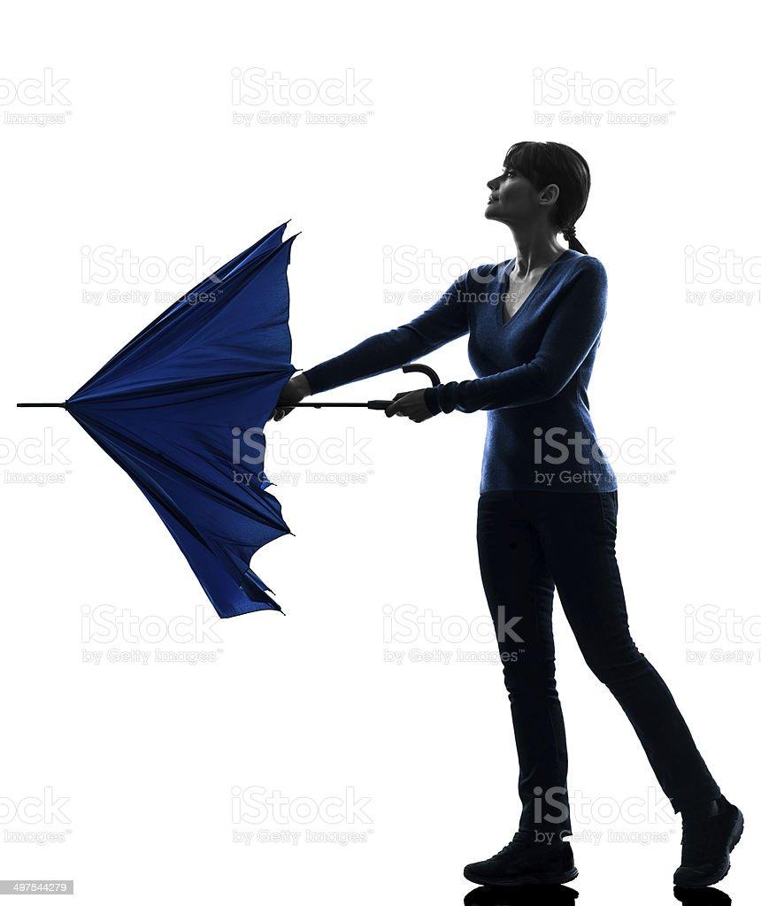 woman opening closing umbrella silhouette stock photo
