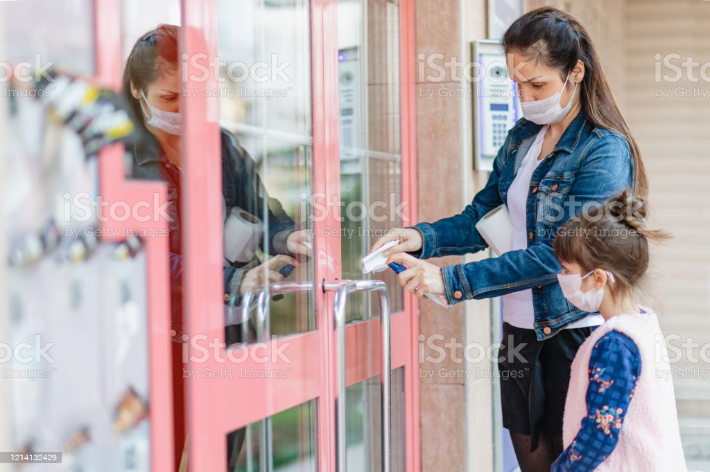 woman opening door handle with a napkin woman opening door handle with a napkin 30-39 Years Stock Photo