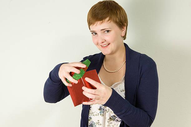 Woman opening gift box stock photo