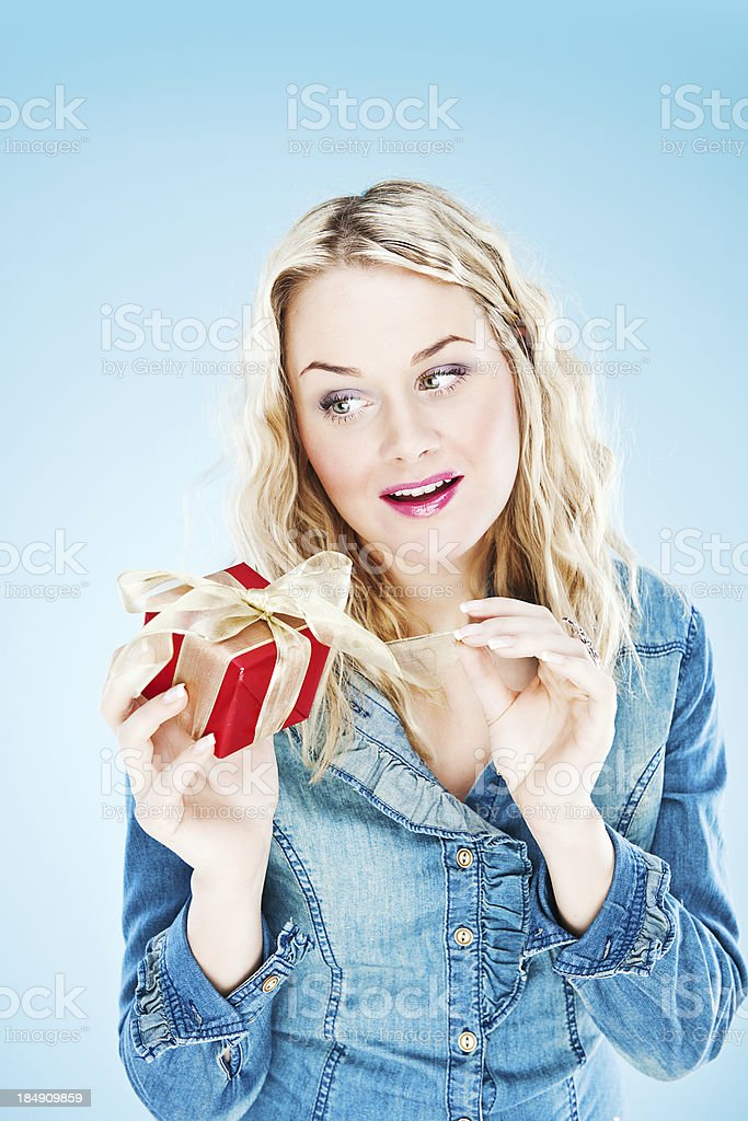 Woman opening gift stock photo