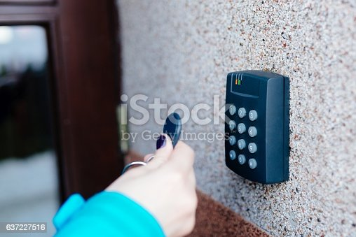 istock Woman opening house doors 637227516