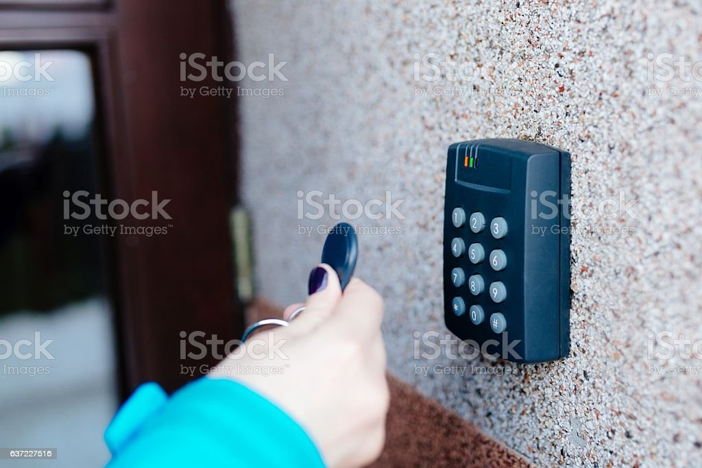 Woman opening house doors stock photo