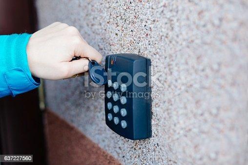istock Woman opening house doors 637227560