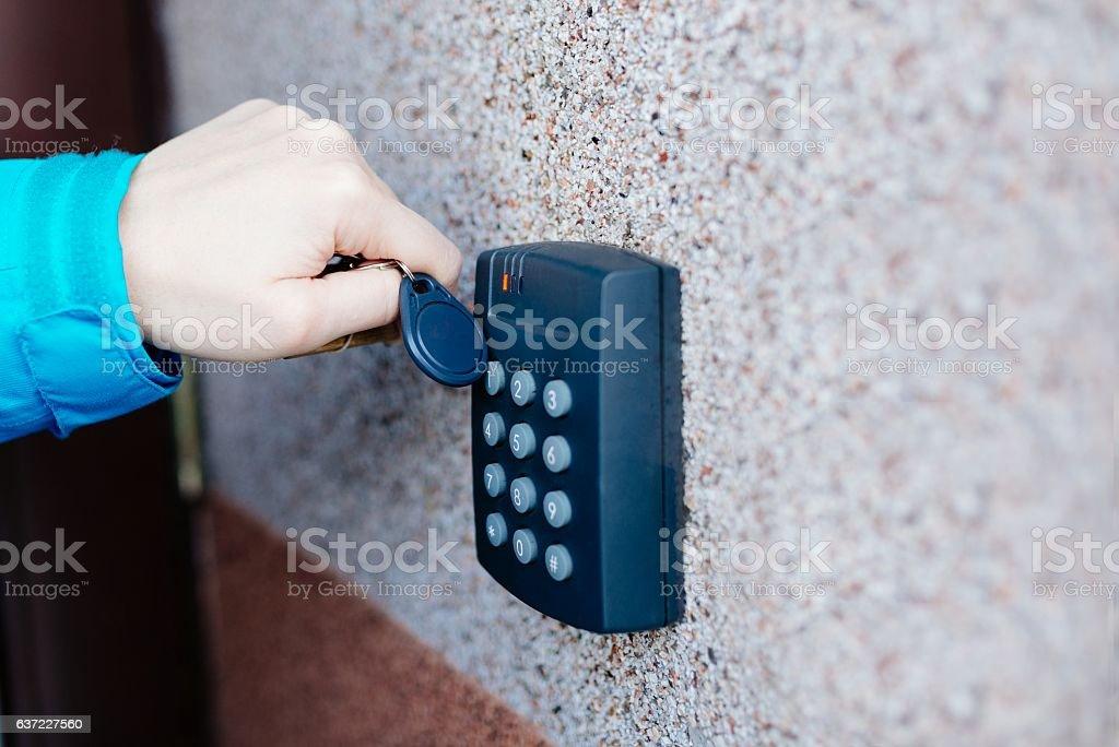 Woman opening house doors stock photo