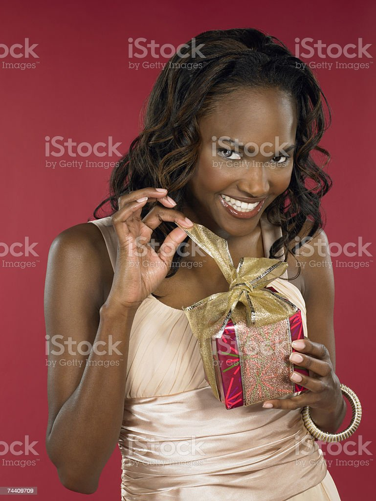 Woman opening present royalty-free stock photo