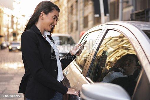 istock Woman opening the car door 1137813727