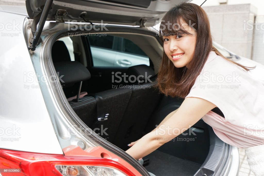 Woman opening the trunk stock photo