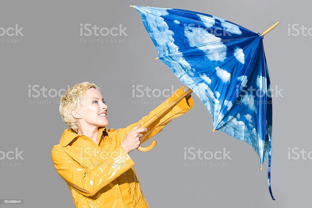 Woman opening umbrella 免版稅 stock photo