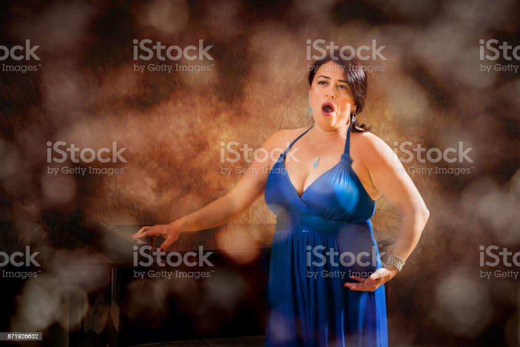 Woman opera singer during performance stock photo