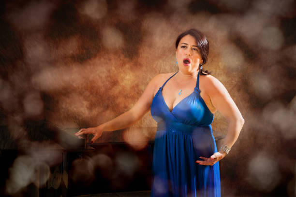 woman opera singer during performance - opera stock photos and pictures