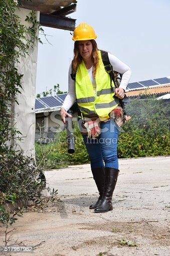 woman operates a leaf blower