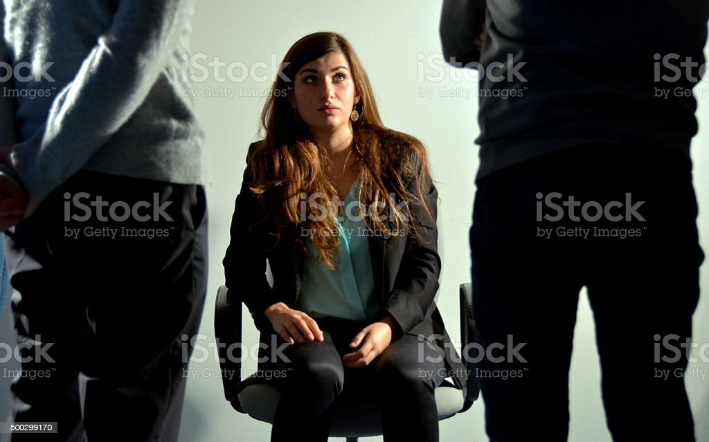 Woman oppressed by men on workplace stock photo