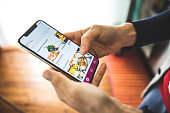 istock Woman ordering food by mobile app delivery at home at social distancing time 1220396235