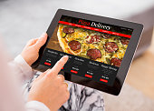 istock Woman ordering pizza online 637238778