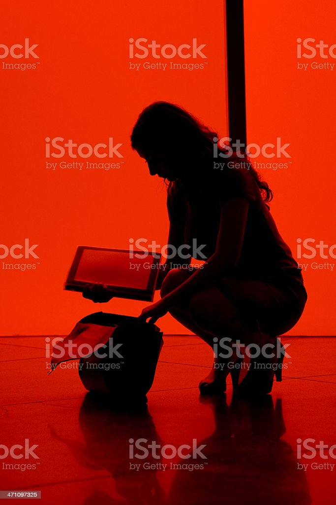 Woman organising Documents. Back Lit Silhouette royalty-free stock photo