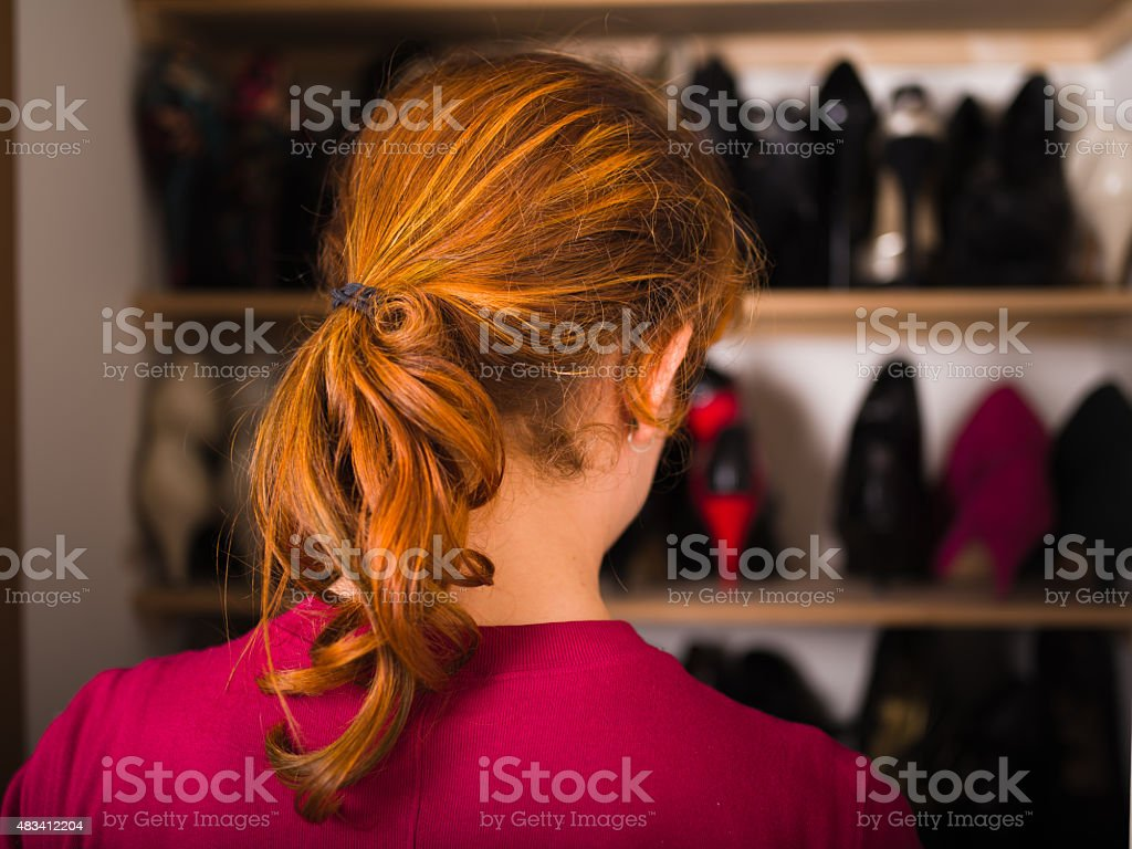 Woman organizing her shoes stock photo