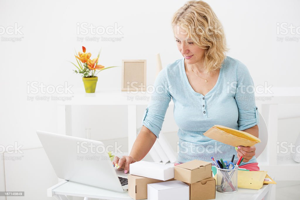 Woman organizing packages for delivery stock photo