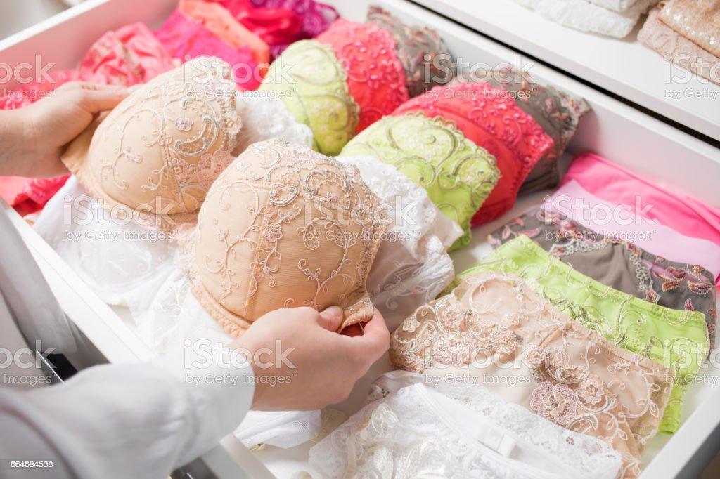 Woman organizing underwear in drawer – Foto