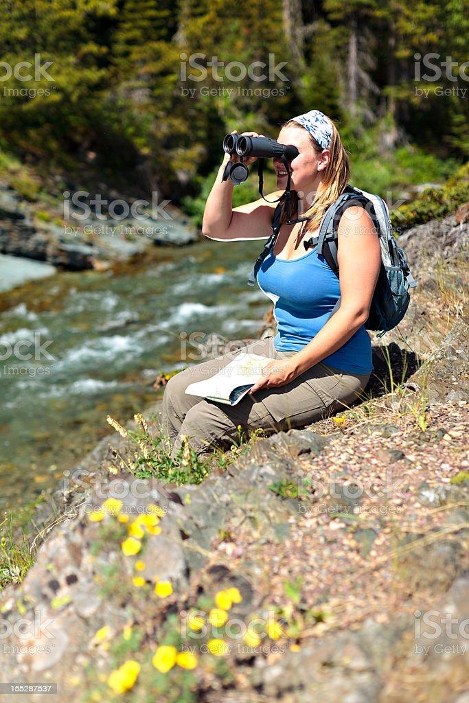 Woman Orienteering Near River stock photo