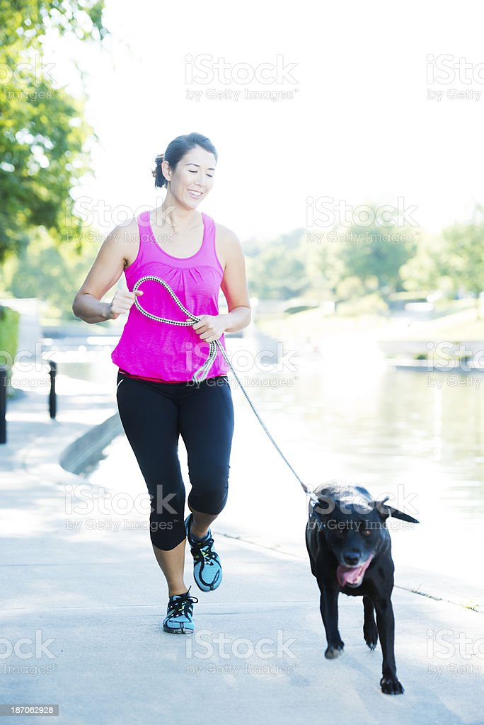 Woman our running with her dog royalty-free stock photo