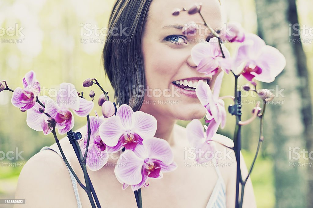 Woman outdoors in nature with orchid royalty-free stock photo