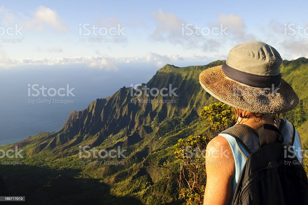 Woman outdoors looking at dramatic view and future on Kauai stock photo