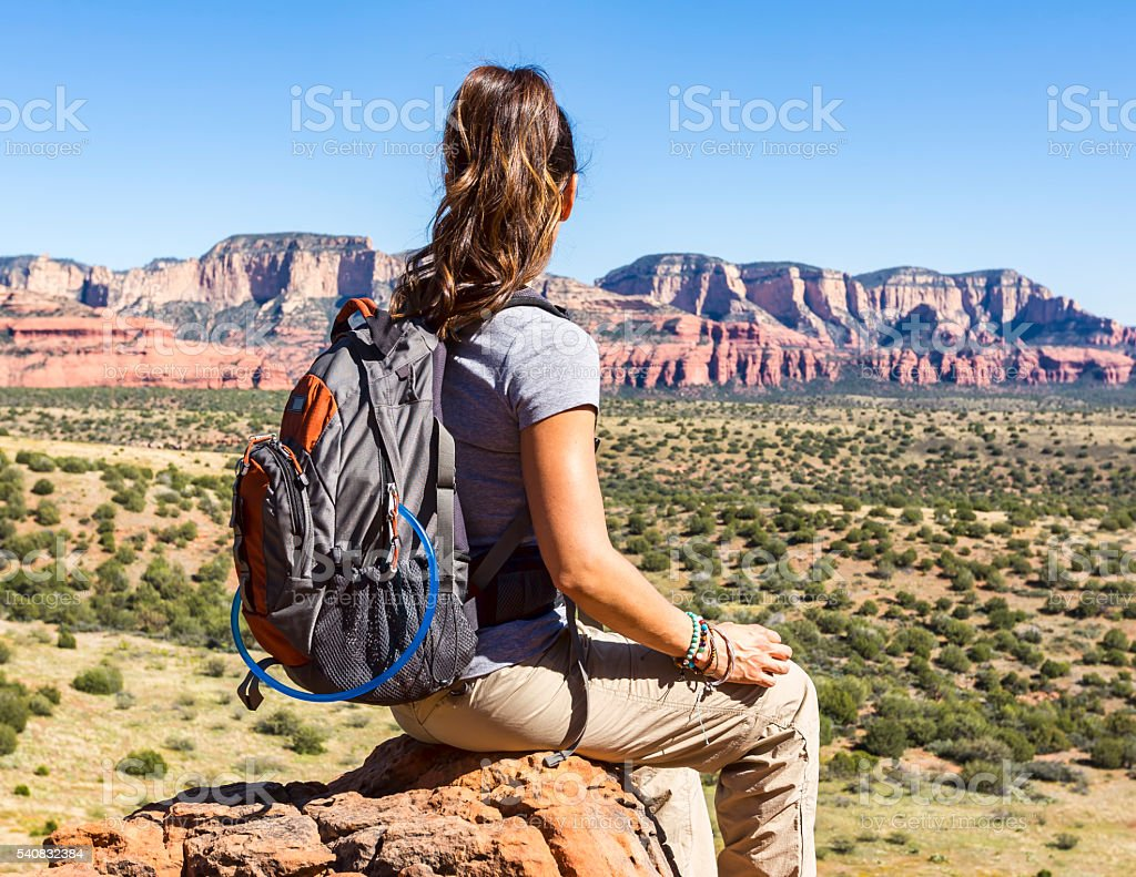 Woman Outdoors Takes a Break From Hiking stock photo
