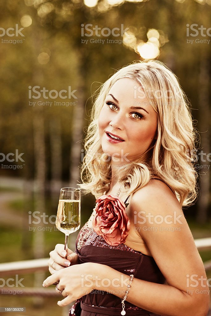 Woman outdoors with champagne royalty-free stock photo