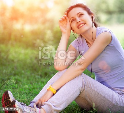 479652946istockphoto woman outdoors with headphones 479652954