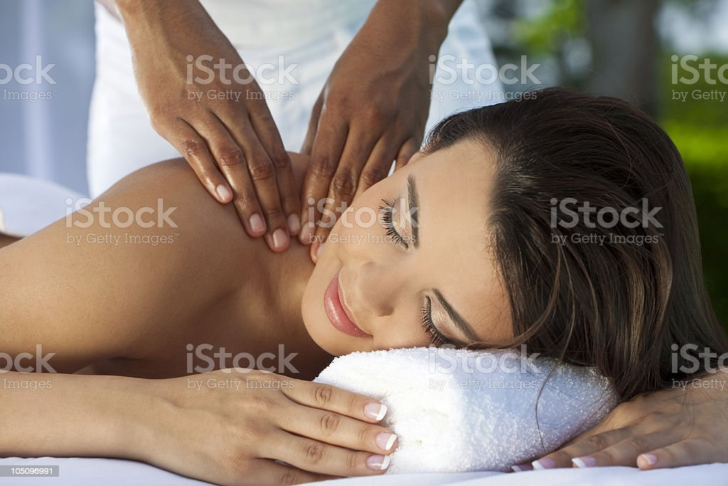 Woman Outside At Health Spa Having Relaxing Massage royalty-free stock photo