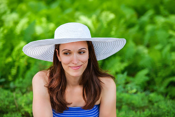 Woman Outside with a Sun Hat stock photo