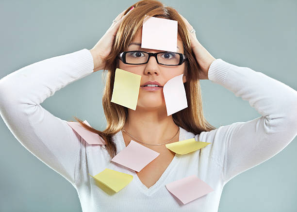 Woman overloaded with information stock photo