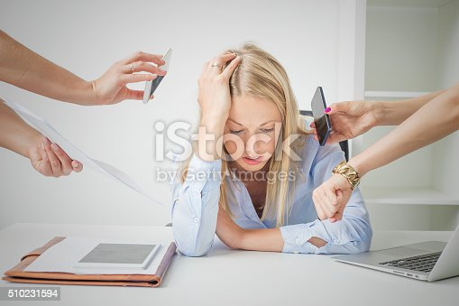 istock Woman overloaded with stuff at work 510231594