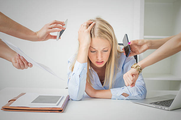 Woman overloaded with stuff at work Work issues: woman overloaded with stuff at work mental burnout stock pictures, royalty-free photos & images
