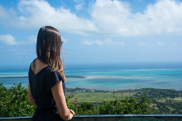 Woman overlooking a view of paradise stock photo